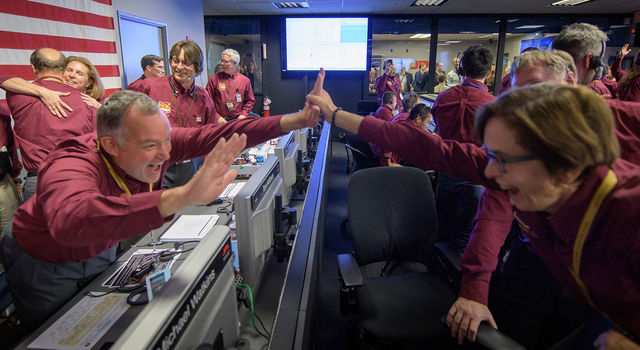 Tom Hoffman, InSight Project Manager, NASA JPL, left, and Sue Smrekar, InSight deputy principal investigator, NASA JPL, react after receiving confirmation InSight is safe on the surface of Mars