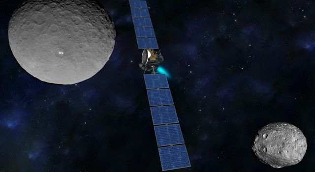 Illustration of NASA's Dawn spacecraft between Ceres and Vesta