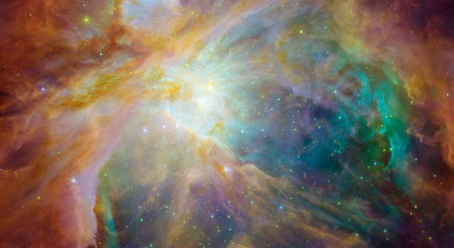 A burst of reds, yellows, greens, blues and purples can be see in this image of the Orion nebula created using data from the Spitzer and Hubble space telescopes.