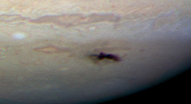 Hubble Space Telescope photo of a scar on Jupiter caused by a comet impact
