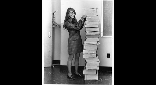 Margaret Hamilton with a stack code she wrote to help get humans to the Moon