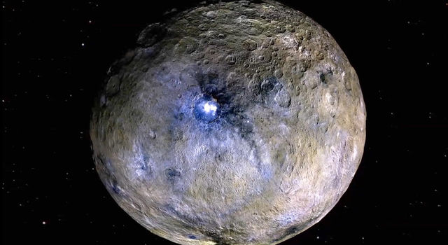 In this rendering made with images from NASA's Dawn spacecraft, the dwarf planet Ceres is shown in false-color to highlight differences in the materials on its surface.