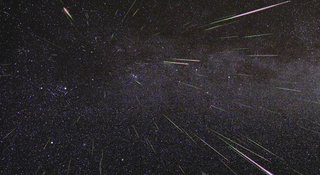 Meteors stream through the sky in this photograph from the Perseid meteor shower in August