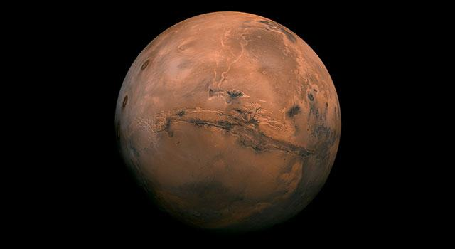 Mars appears in deep orange-red against the black backdrop of space