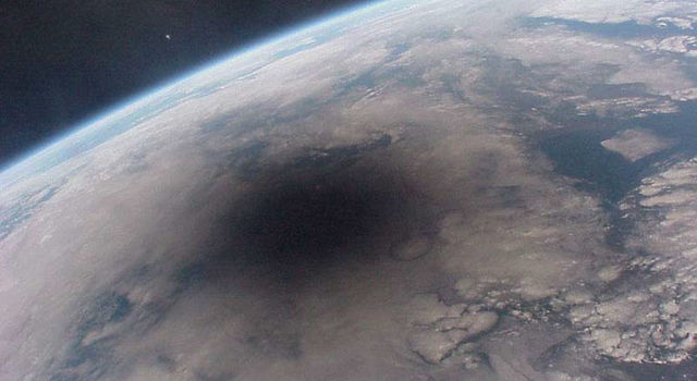 A satellite image of the Moon's shadow on Earth during a total solar eclipse