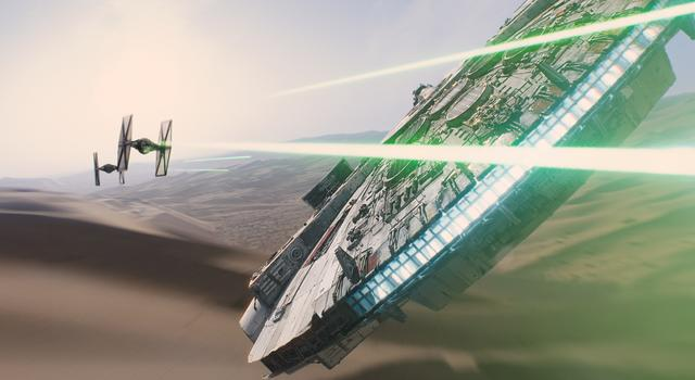 The Millennium Falcon takes on TIE fighters in a scene from 'Star Wars: The Force Awakens.'