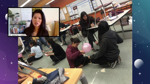 A screengrab from a web meeting shows a small window with Jayme Wisdom speaking to students and a picture of students attaching a balloon to a string.