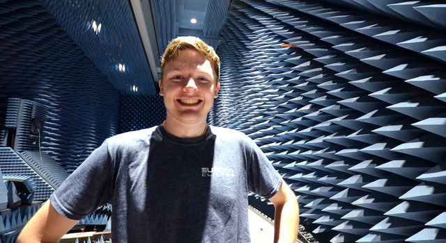 JPL intern Zachary Luppen stands in an anechoic chamber